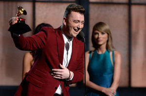 Sam Smith receiving New Artist of the Year Award from artist Taylor Swift.