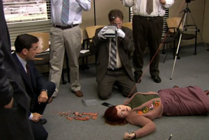 Michael distracts his employees with an over the top murder mystery game.