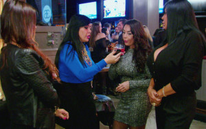 The cast of Mob Wives having a discussion, during a party.