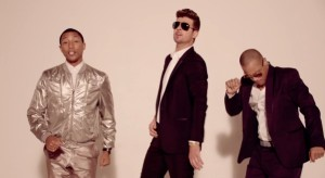 "Pharrell Williams, Robin Thicke and T.I. in their ""Blurred Lines"" music video."