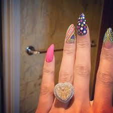 Nick Minaj is sporting an estimated 15-carat yellow heart-shaped engagement ring.