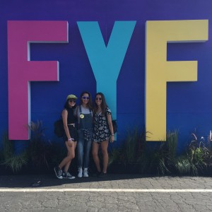 Attendees posing in front of FYF sign