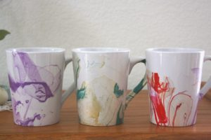 multicolored watercolor mugs